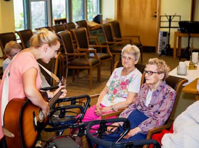 Music Therapist with 2 residents.jpg