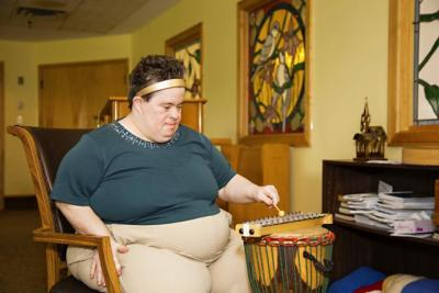 Music Therapy - resident playing drums.jpg