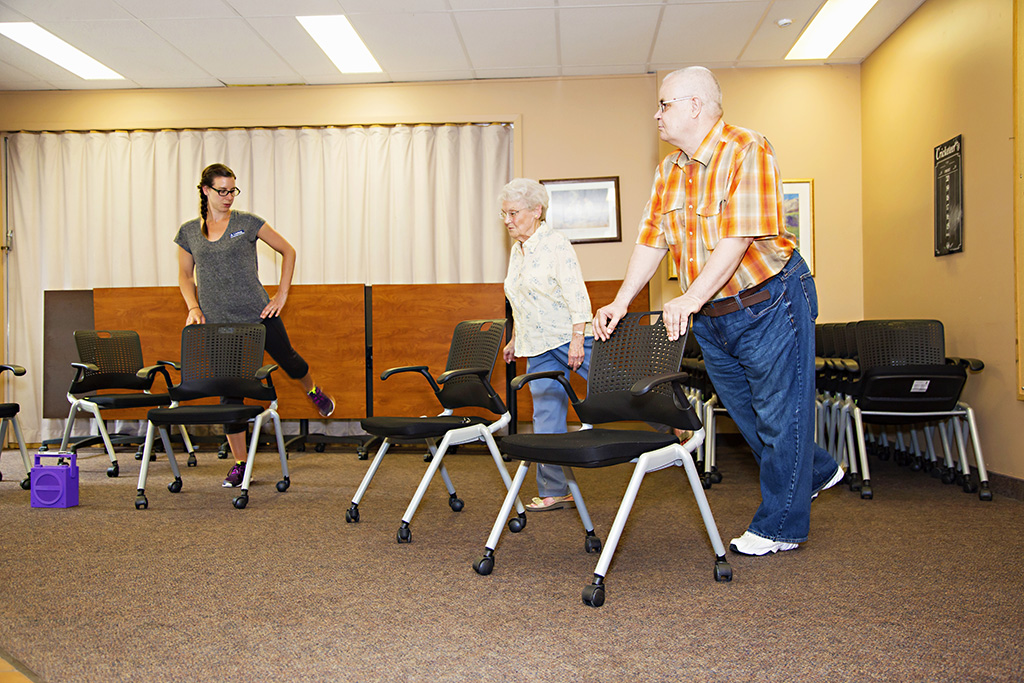 Instructor teaching chair excercise class