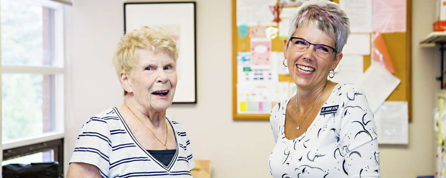 Support service Manager and Resident laughing together