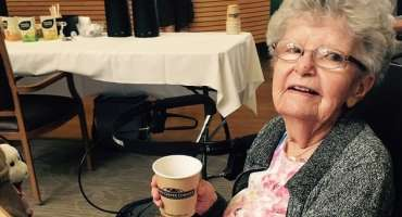 Resident enjoying a beverage and snack at the trade show